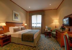 골든 튤립 알 바르샤 호텔 - 두바이 - 침실