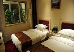 Super 8 Hotel Beijing Bei Hai Park West Gate - 베이징 - 침실