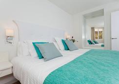 FERGUS Style Cala Blanca Suites - 산타 폰사 - 침실