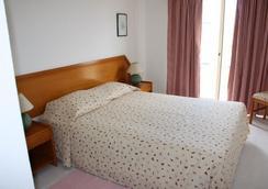 Apartamentos Turisticos Presidente - 포티마오 - 침실