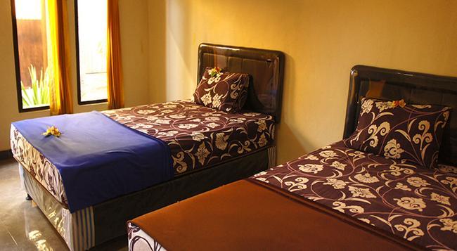 비다다리 호텔 - 쿠타 - 침실