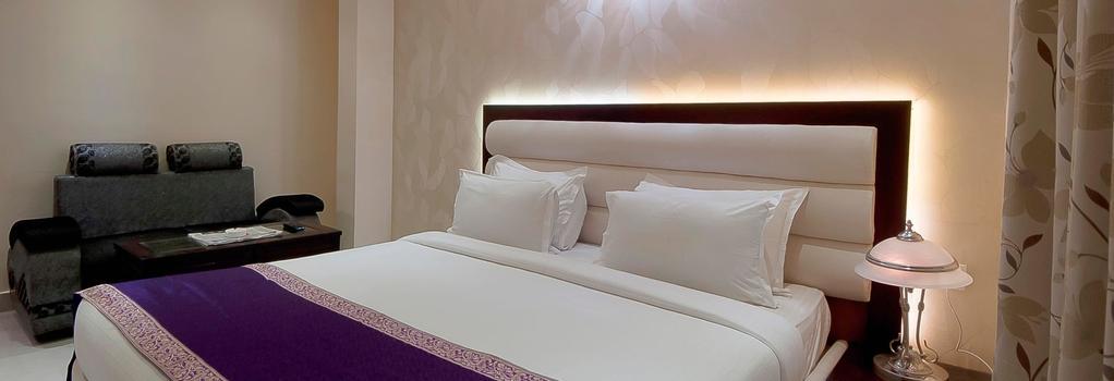 호텔 센트럴 레지던시 - 바라나시 - 침실