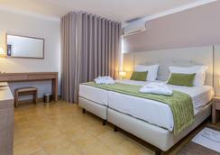Santa Eulalia Hotel & Spa - 알부페이라 - 침실