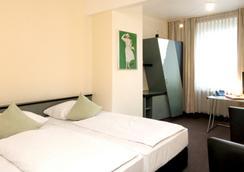 모노폴 호텔 - 뒤셀도르프 - 침실