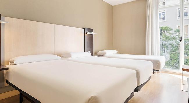 일루니온 오디토리 호텔 - 바르셀로나 - 침실