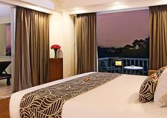 쿠타 파라디소 호텔 - 쿠타 - 침실