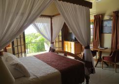 Charela Inn - 네그릴 - 침실