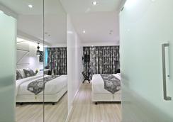 S 수쿰윗 스위트 호텔 - 방콕 - 침실