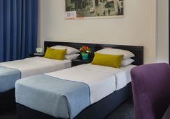 포트 호텔 텔 아비브 - 텔아비브 - 침실