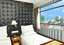 호텔 그랜드 유니아티드 앳 21st 다운타운 - 양곤 - 침실