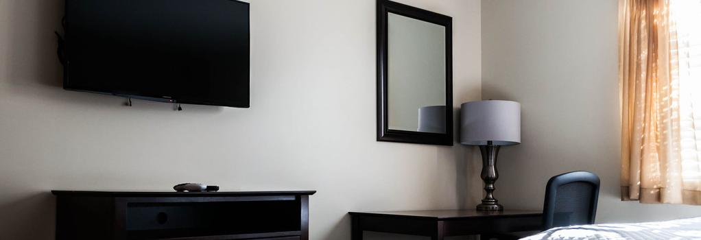 Holmesuites Inn - 콜럼버스 - 침실