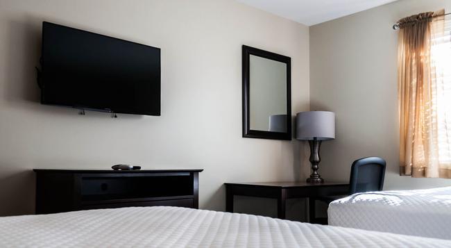 Holmes Suites & Inn - 콜럼버스 - 침실
