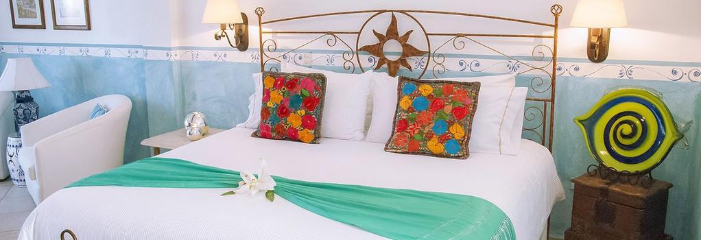 Encanto Inn Hotel, Spa & Suites - 산호세 델 카보 - 침실