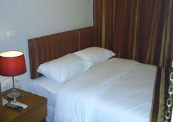 선 시티 호텔 - 방콕 - 침실
