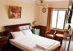 탄 호앙 마이 호텔 - 호치민 - 침실