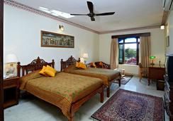 호텔 메그니와스 - 자이푸르 - 침실