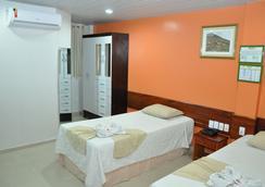프로타 팰리스 호텔 - Macapá - 침실