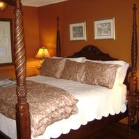 The Hibiscus House Bed & Breakfast Massive four-poster bed welcomes you to the Palm Room.