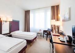 아지무트 호텔 뮌헨 - 뮌헨 - 침실