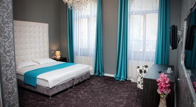 Siago Hotel - 클루이나포카 - 침실