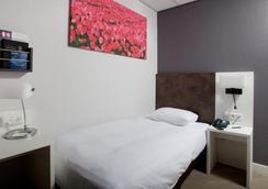 호텔 암스테르담 드 로드 리우 - 암스테르담 - 침실