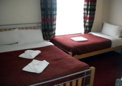 Royal Guest House - 런던 - 침실