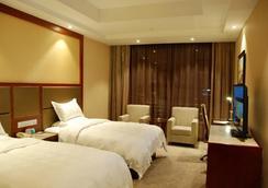그린트리 이스턴 쿠저우 헤우 로드 호텔 - Quzhou - 침실