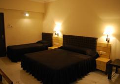 Hotel Millennium - Guwahati - 침실