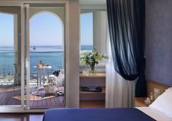 호텔 티파니스 - 리치오네 - 침실