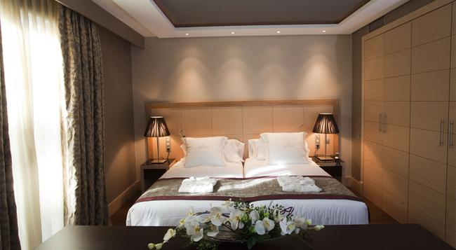 Nexus Valladolid Suites & Hotel - 바야돌리드 - 침실