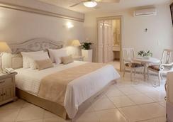 호텔 앤드 스위트 퀸타 마그나 - 과달라하라 - 침실