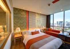 빠뚜남 프린세스 호텔 - 방콕 - 침실