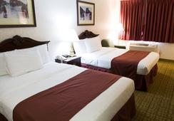 GuestHouse Inn & Suites Sioux Falls - 수폴스 - 침실