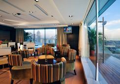 페닌슐라 액셀시어 호텔 - 싱가포르 - 라운지
