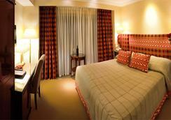 스위스 호텔 - 리보프 - 침실