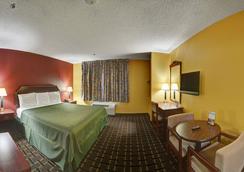 Americas Best Value Inn & Suites - 롱뷰 - 침실