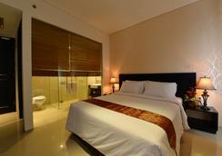 에밀리아 호텔 바이 어메이징- 팔렘방 - 팔렘방 - 침실
