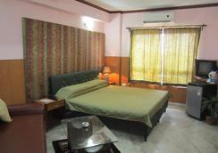 Malik Guest House - 콜카타 - 침실
