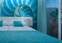 호텔 아파르타멘토스 마리나 플라야 - 성인 전용 - 산 안토니오 - 침실