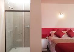 콘셉트 디자인 호스텔 & 스위트 - 포스두이구아수 - 침실
