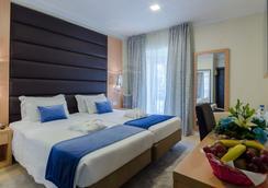 Hotel Americano Inn Rossio - 리스본 - 침실