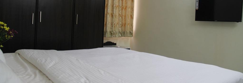 이지 스테이 - 하이데라바드 - 침실