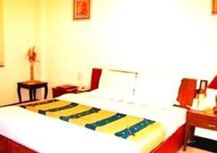 호텔 피알 레지덴시 - 암리차르 - 침실