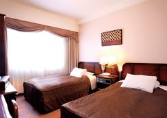 클라이톤 신오사카 호텔 - 오사카 - 침실