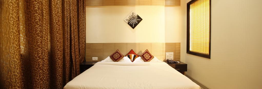Fabhotel Arafa Inn Gandhinagar - 벵갈루루 - 침실