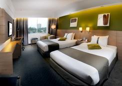 그랜드 마가리타 호텔 - 쿠칭 - 침실