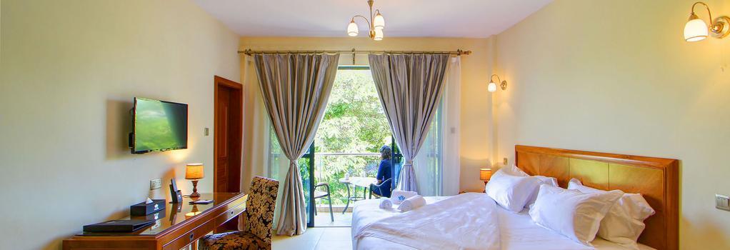 Lotos Inn & Suites - 나이로비 - 침실
