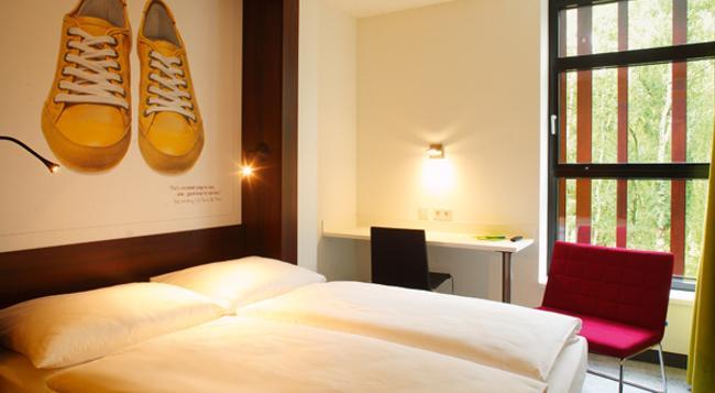 7THINGS Hotel - 브레멘 - 침실