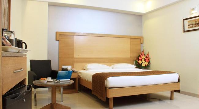 호텔 캐너리 사파이어 - CRN - 벵갈루루 - 침실