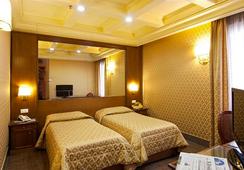 매디슨 호텔 - 로마 - 침실